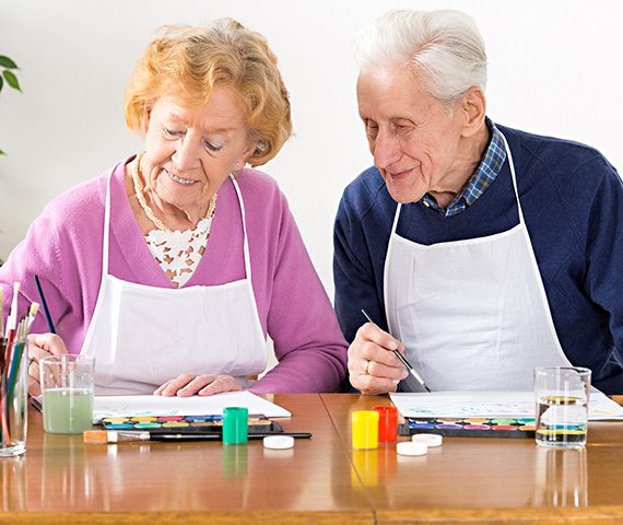 Senior couple painting with water colors