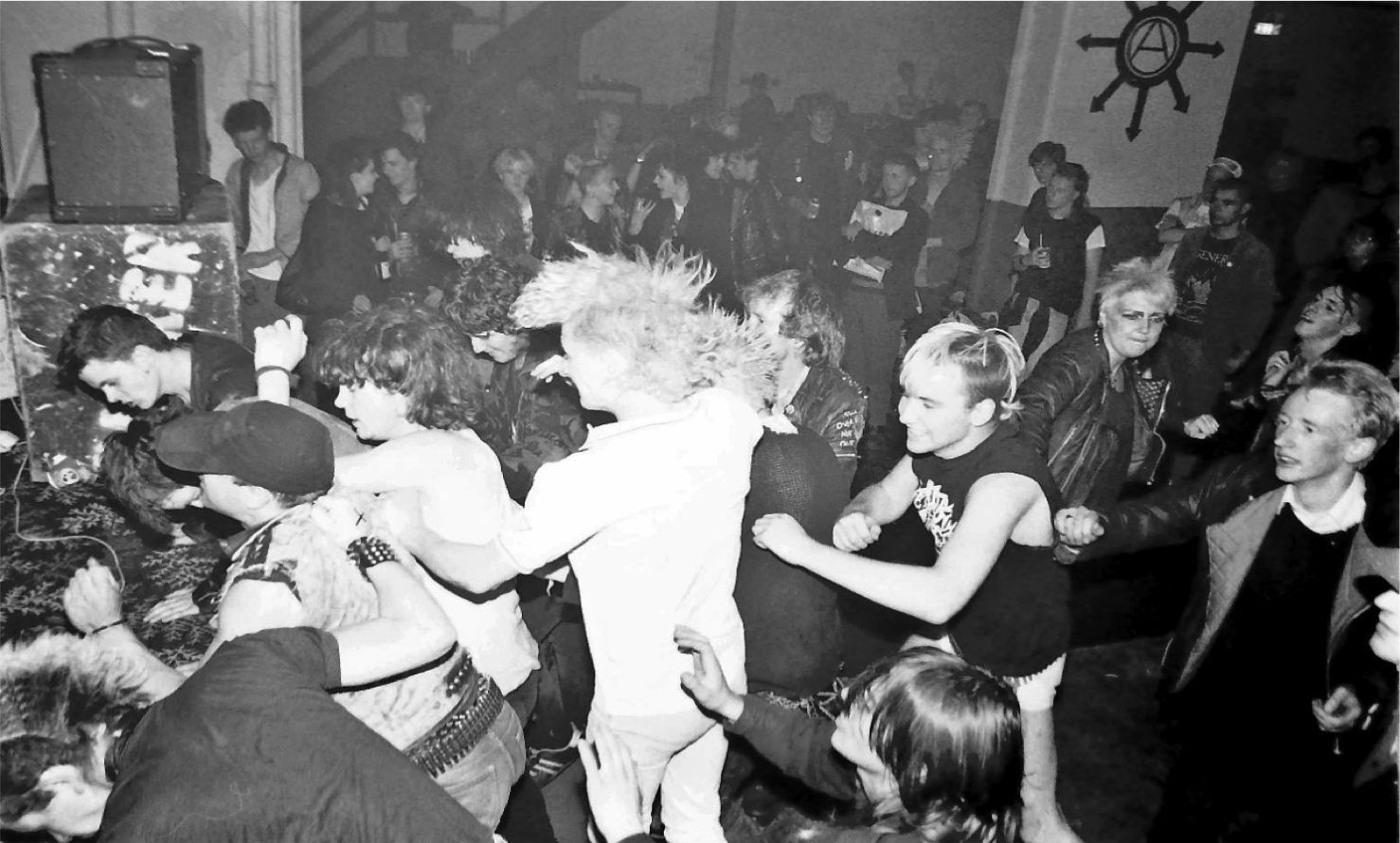 Gig Crowd, Stockton Road Bunker 1984 Image by Andrew Medcalf Logo