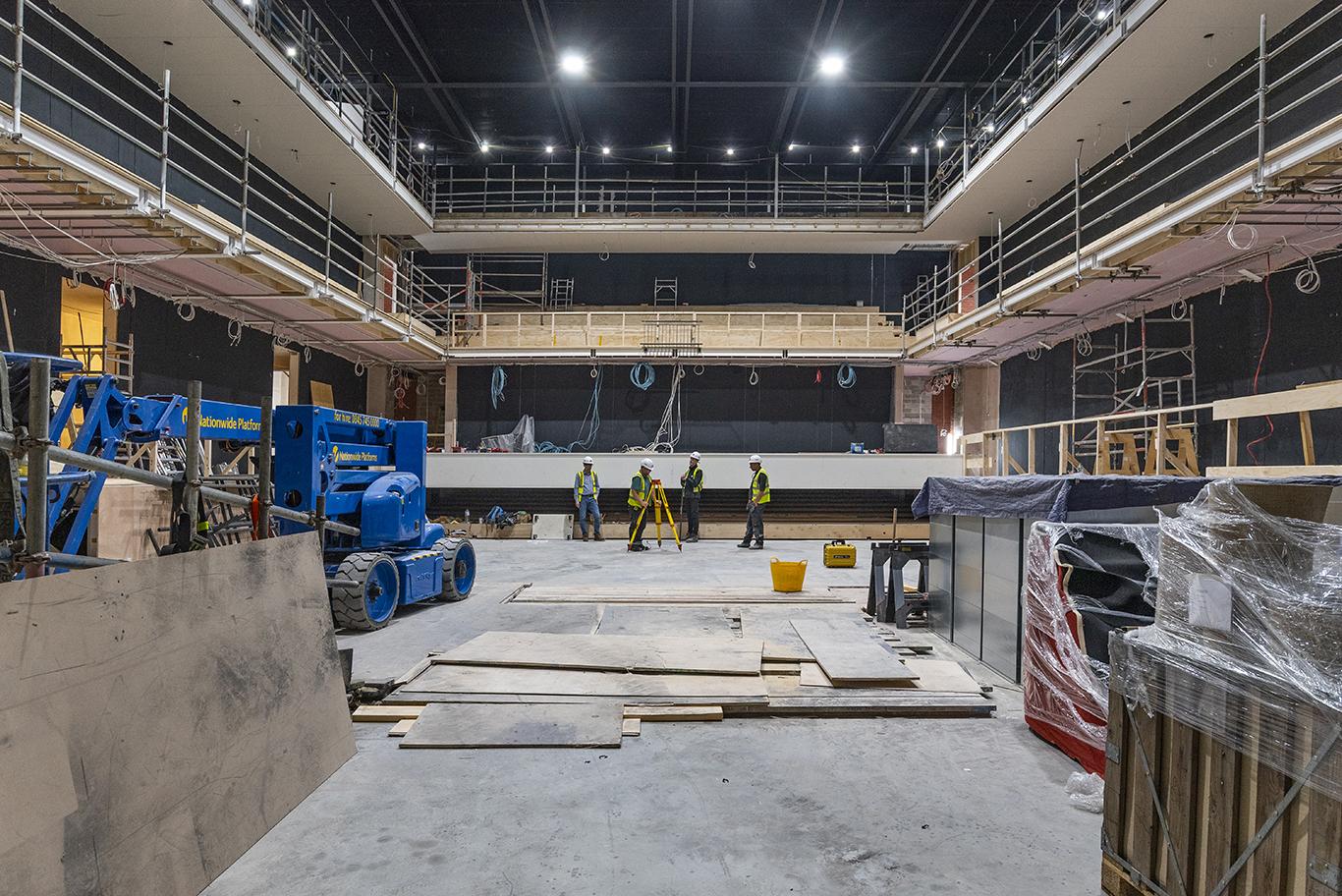 Inside The Fire Station Auditorium under construction Logo